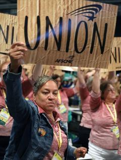 AFSCME member holds union sign at 2018 convention